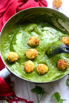 Corn koftas in a spinach curry