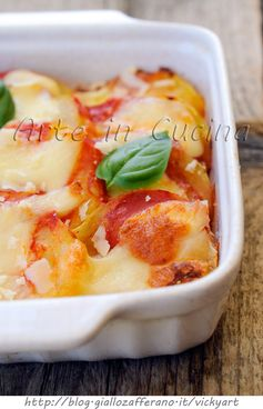 Patate con mozzarella e pomodoro al forno